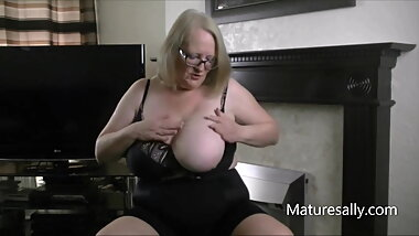 Mature Sally in black bra and shaper pants