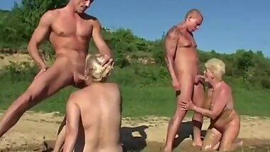 2 Grannies fucked in the mud outdoors