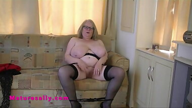 Huge tits English Granny strips and masturbates