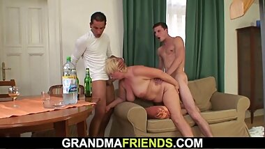 blonde granny is picked up and double fucked