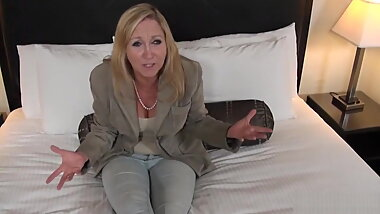 Mature blonde takes on a big white cock